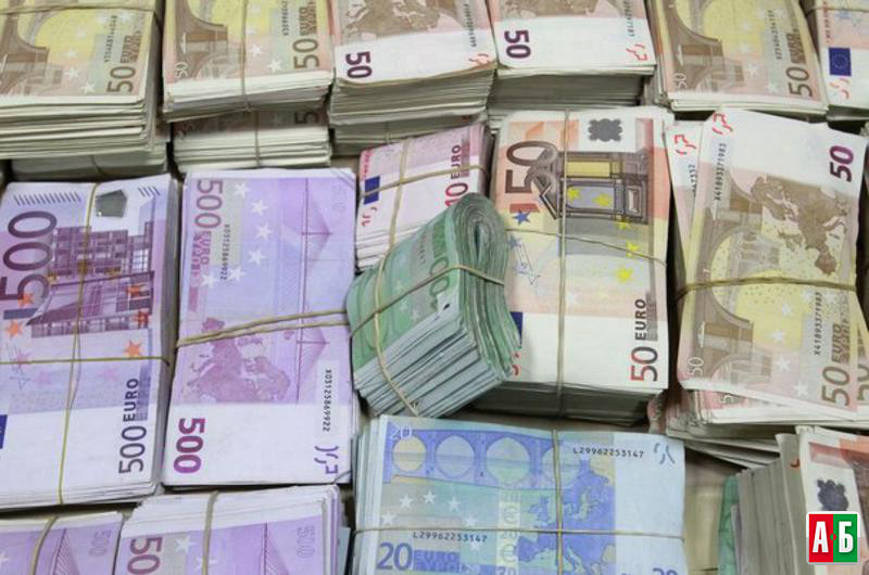 Bundles of confiscated money are displayed at a police headquarter in Madrid